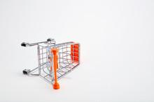 Overturned Shopping Cart On White Background