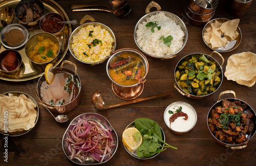 Variety of South Indian dishes on a wooden table served in traditional copperwar Tapéta, Fotótapéta