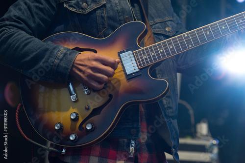 man playing guitar - 311198308