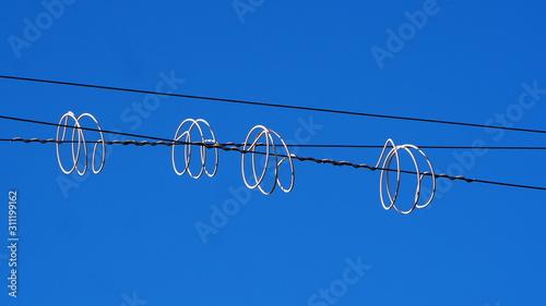Fényképezés Anillos de Protección eléctrico reflejados por el sol, Lérida, Cataluña, España