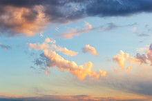 Beautiful Golden Cloud In A Blue Sky Just Before Sunset. Scenic Sundown Cloudscape For Background. Afterglow Of Sunset.