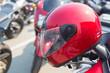 Red motorcycle helmet on a motorcycle