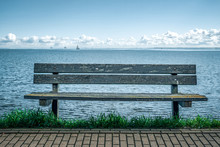 A Bench On The Embankment Agai...