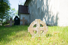 Old Graveyard Around Noarootsi Lutheran Church With A Sun Cross (also Called Solar Cross, Or Wheel Cross) Which Is An Ancient Solar Symbol Consisting Of An Equilateral Cross Inside A Circle. Sunny Day