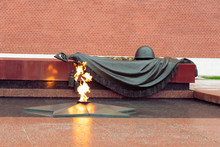 Tomb Of The Unknown Soldier With A Burning Flame, Eternal Flame Near The Kremlin Wall In Moscow