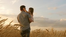 Little Daughter On Fathers Shoulders. Happy Child And Father Are Playing In Field Of Ripening Wheat. Baby Boy And Dad Travel On Field. Kid And Parent Play In Nature. Happy Family And Childhood Concept