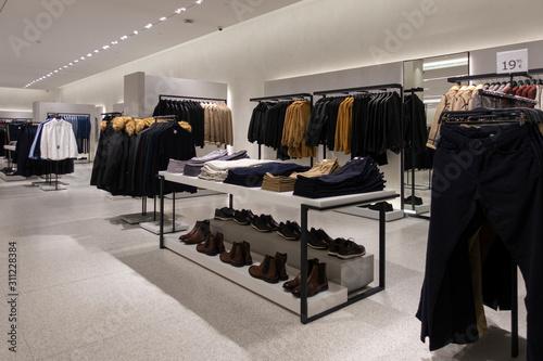 Fototapeta Modern fashionable brand interior of clothing store inside shopping center