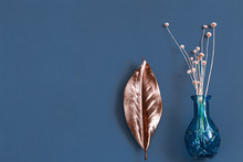 Dried Flowers And A Vase On A Blue Background.
