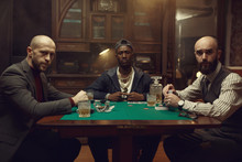 Poker Players With Cards Playi...