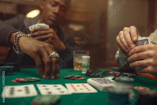 Obraz na plátně  Two poker players place bets in casino