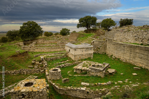 Fototapeta Sanctuary walls and wells of Troy VI at archeological site near Hisarlik Turkey
