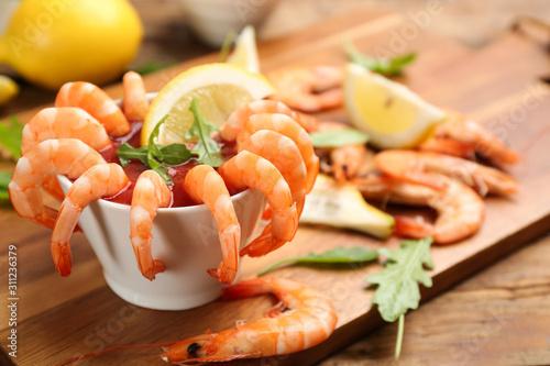 Valokuvatapetti Delicious shrimp cocktail served on board, closeup