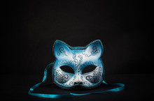 Coloured Cat-shaped Carnival Mask For A Celebration In A Secluded Background