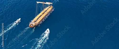 Photo  Aerial drone ultra wide photo of beautiful replica of ancient Athenian Trireme c