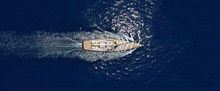 Aerial Drone Ultra Wide Photo Of Luxury Sail Boat With Wooden Deck Cruising Deep Blue Aegean Sea, Greece