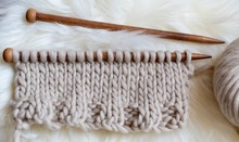 Knitting On Needles In Neutral...