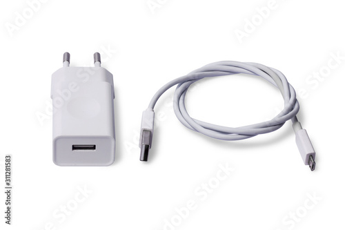 Photo White Adapter Charger with usb cable isolate on white background.