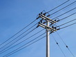 High voltage cable on the pole On the blue sky background With copy space