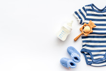 Baby Background - Blue Color. Clothes And Accessories For Newborn Boy On White Table Top-down Frame Copy Space
