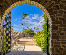 Stone Walls And Arched Gate Of...