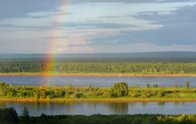 Rainbow Over The River And Forest. Bright Rainbow.