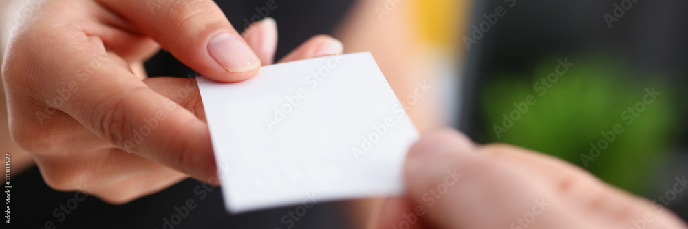Fototapeta businesswoman give her business card to her new partner closeup
