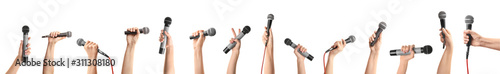 Photo Female hands with microphones on white background