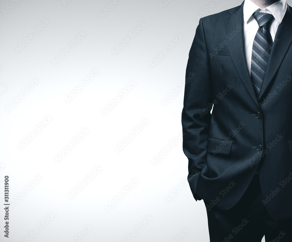 Fototapeta Businessman in black suit