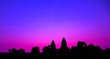 canvas print picture - Angkor Wat temple facade Purple silhouette