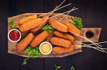 Traditional American Corn Dogs With Mustard And Ketchup On Wooden Board. Street Food. Top View, Copy Space