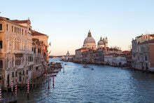 View From  Accademia Bridge Of The Grand Canal And Basilica Santa Maria Della Salute, Venice, Italy At Sunset