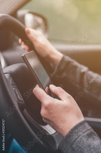 Fotografia, Obraz Texting and driving is dangerous behavior in traffic