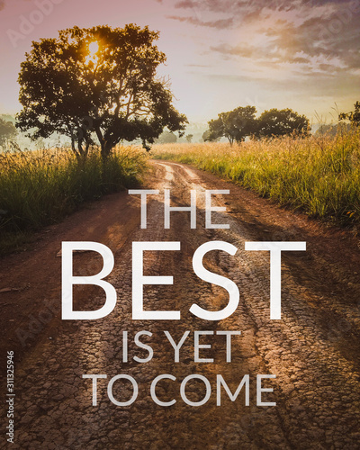 Inspirational and motivation quote on road in nature background with vintage filter.