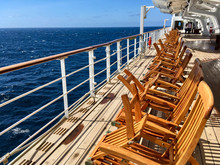 Wooden Deck Chairs On Luxury A...