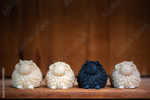 Photo Being the black sheep of the family is illustrated with these artistic handmade black and white soap sheep