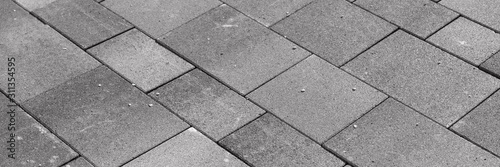 New gray paving stones in the driveway. Gray background