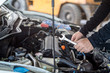 Hand of mechanic man hold spanner tool, inspection and maintenance car service
