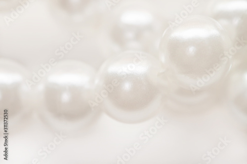 Macro white pearl beads string isolated background Canvas Print
