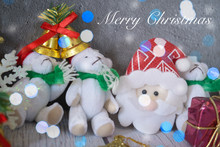 Merry Christmas Party Concept, Santa Claus And White Bears Dolls With Snow Light Bokeh