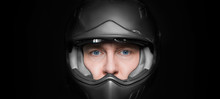 Man In Motorcyclist Helmet On ...