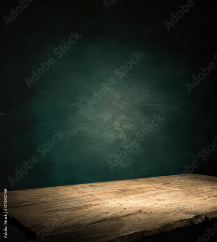Wood table in front of rustic brick wall blur background with empty copy space on the table for product display mockup. Retro design montage presentation. - 311380786