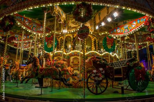 Obraz na plátně Beautiful big christmas carousel with lights