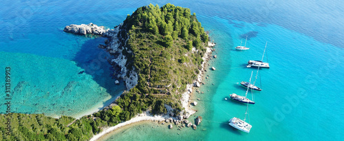 Aerial drone ultra wide panoramic photo of tropical exotic seascape in Mediterranean Greek Ionian island of Paxos with turquoise sea