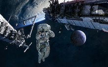 Astronaut, ISS In Orbit Of Earth. Moon. Solar System. Science Fiction. Elements Of This Image Furnished By NASA