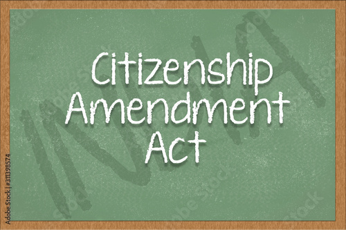 Photo citizenship amendment act written on green black board with India as a background