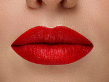 Cosmetics, Makeup And Trends. Bright Lip Gloss And Lipstick On Lips. Closeup Of Beautiful Female Mouth With Red And Pink Lip Makeup. Beautiful Part Of Female Face. Perfect Clean Skin