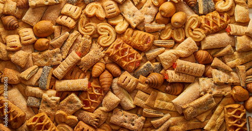 Cuadros en Lienzo Top view of a variety of cookies Texture (background) of the cookie in the studio Cookies wallpaper background Backgrounds and textures: group of various cookies Concept of food and pastry products