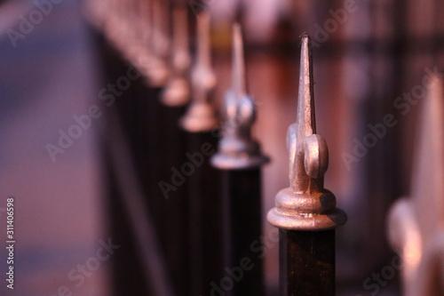 Leinwand Poster metal fence chess like peaks