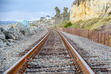 Railroad Tracks Between The Pacific Ocean And Bluffs In San Clemente California