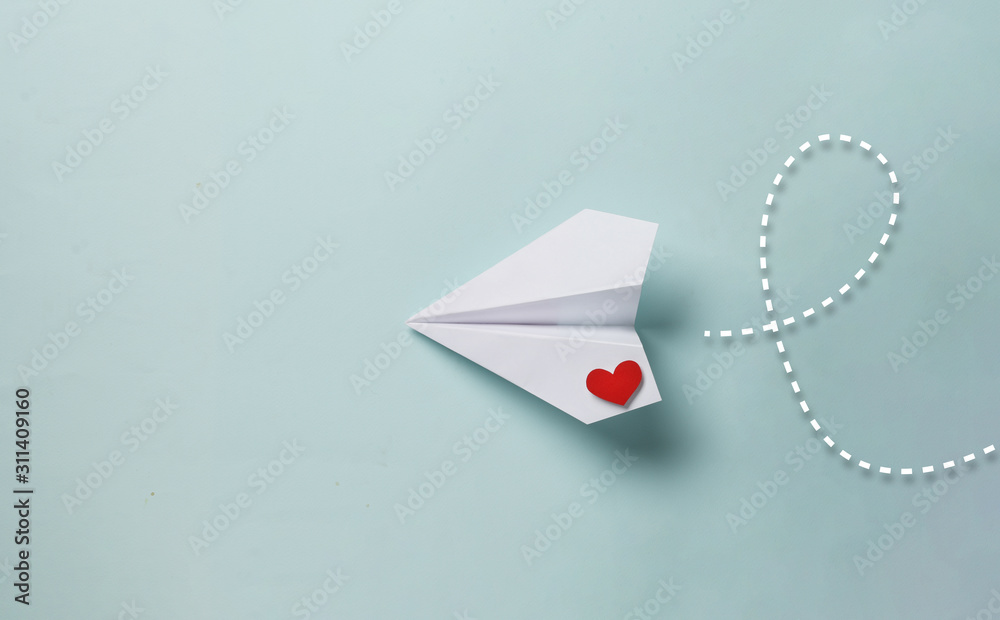 Fototapeta paper love airplane on color background..The concept of a love message. Valentine's Day. Declare love. Love note.